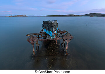 old boat on a rusty iron frame