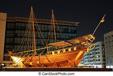 old boat on display near fahidi fort at Dubai Museum, UAE