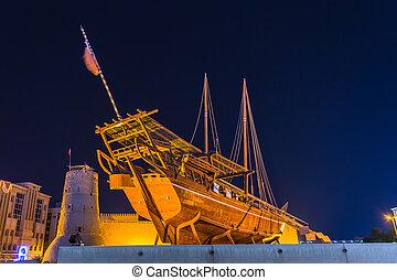 old boat on display near fahidi fort at Dubai Museum