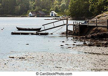 Old boat on lake shore coast