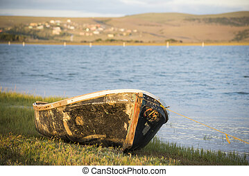 Old boat on river bank