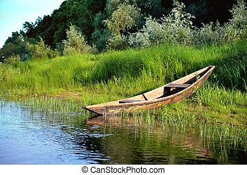 old boat riverside green grass, green trees, blue sky