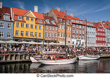 Old boats and houses in Nyhavn in Copenhagen