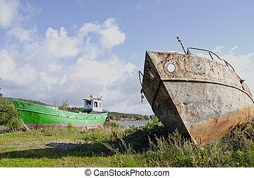 old boats on the sea coast