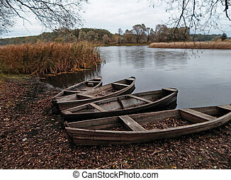 Old boats on the shore.