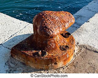 Old bollard in harbor