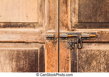 old bolt on a wooden door