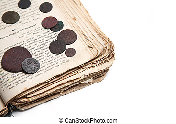 Old book and coins - Old coins and age-old book isolated on...
