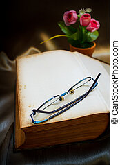 Old book and glasses.