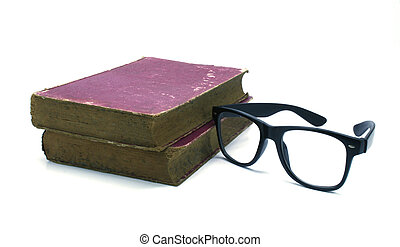 Old book and glasses on a white background