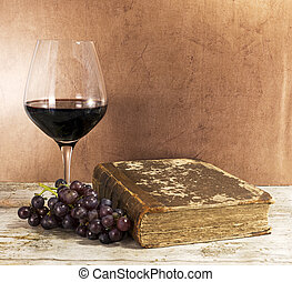 old book and red wine