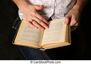 Old book - Female hands with the old book