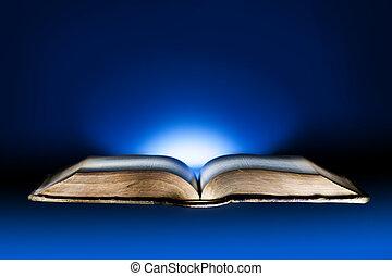 Old book, mystical blue light background