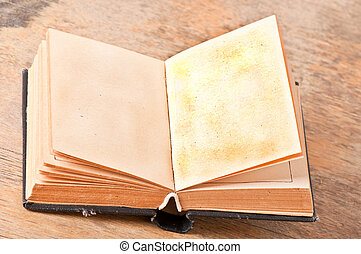 old book on a background of wood