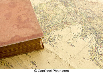 Old book on vintage map