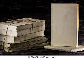 old book on wooden background. - stacked books on a wooden...
