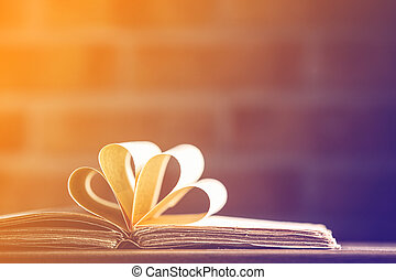 old book on wooden table at fairy lights background