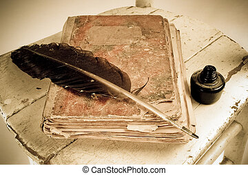 Old book, quill and black ink