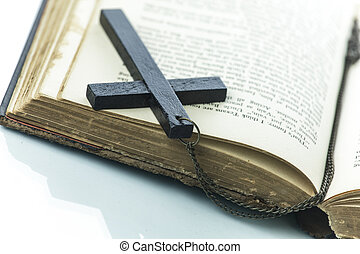 Old book with a cross