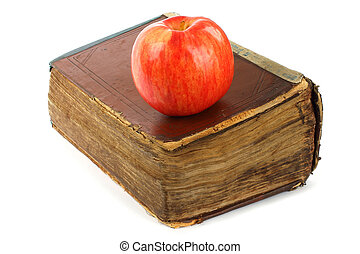 Old book with apple on a white background