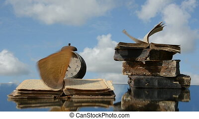 old books and wind