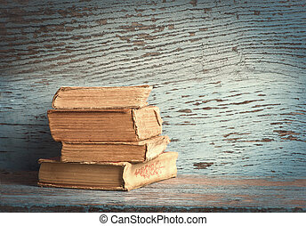 old books on a wooden background
