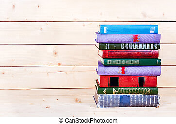 Old books on a wooden shelf. funds for education