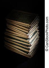 Old books on black textured
