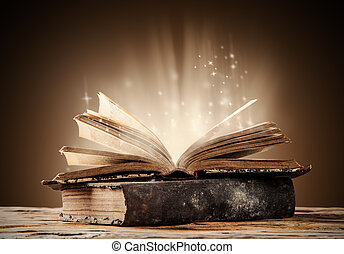 Old books on wooden planks with blur shimmer background
