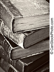 Old Books - Sepia toned image of a stack of old worn books.