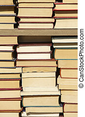 Old books staked on a case