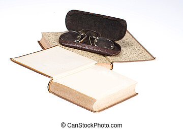 Old books with eye-glasses