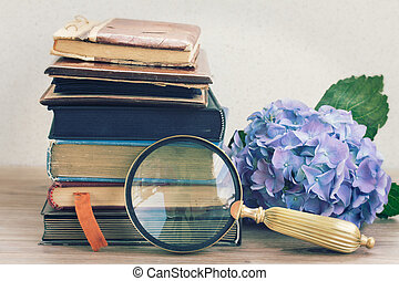 old books with flowers and looking glass - vintage old books...
