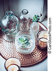 Old bottles, candles on a copper vintage tray, vintage home...