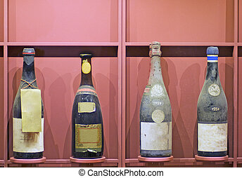Old bottles - Exposition of four old and dusty bottles of...