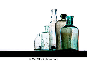 old bottles in a row on white