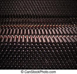 Old bottles of red wine - Dark cellar with old bottles of...