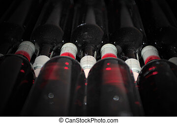 Old bottles of red wine - Dark cellar with old bottles of...