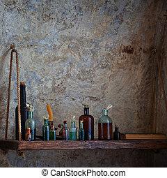 Old bottles of various liquids on the shelf