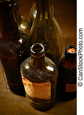 Old bottles - Old tagged bottles with transparent liquid...
