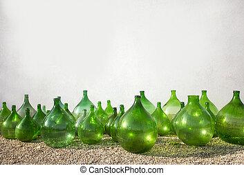 old bottles - old green bottles of wine, olive oil on white...