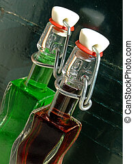 Old bottles - Two old bottles with colored liquid