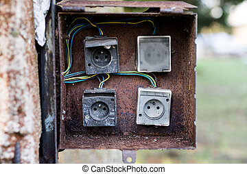 Old box used for electrical installations. Space for wires and electric fuses.