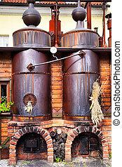 Old brewery - workshop with black steel vats