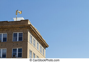 Old Brick Building And Civil Defense Siren - The top corner...
