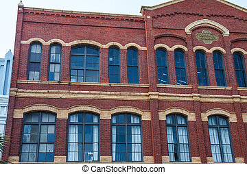 Old Brick Building with Arched Windows with Bronze Plaque