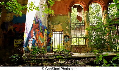 Old brick building with graffiti on walls