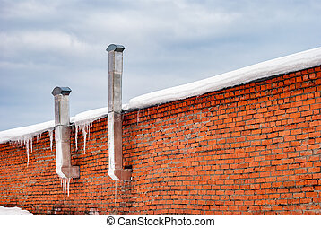 Old brick building with pipes
