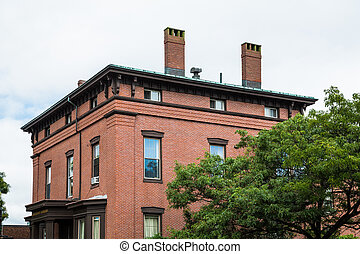 Old Brick Building with Two Chimneys