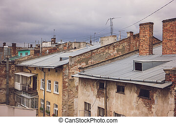 Old brick buildings. Rooftops and gloomy sky. Every street...